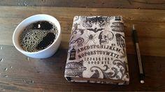 Ouija board sketchbook.  So cute!  #ouijaboard #halloween2017 #halloweendecor #blank #blankbooks #sketchbook #art #mugs #grey