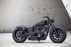 Take a look at the latest custom motorcycle from Rough Crafts, a murdered-out Harley Dyna Fat Bob. We're in love.