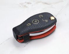StoryLeather.com - Ready to Ship Coaster Genuine Leather Key Cover in Blue Pebble... Leather Key, Leather Cover, Mercedes Accessories, Leather Coasters, Key Covers, Black Pebbles, One Pic, Mercedes Benz, Sunglasses Case