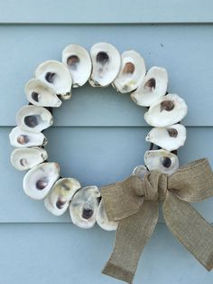 Oyster shell wreath with burlap bow by PalmettoPearlDesigns