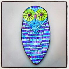 "Colorful Snowy Owl by Kasia Polkowska, stained glass mosaic, 16.75"" x 8."" silhouette 2015"