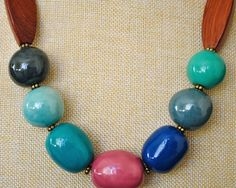 This one of a kind statement necklace is a beautiful piece of fair trade jewelry. It is a chunky necklace made of Kazuri beads and upcycled recycled beads. This bright necklace is would make a great eco friendly gift.