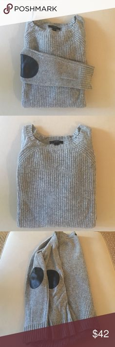 J.Crew Wool Gray Sweater w/ Leather Elbow Patches J.Crew Wool Gray Sweater with Leather Elbow Patches. Sweater is 100% Wool with two leather patches on each arm. Size XS. Dry Clean only. Sweater lightly worn, like new. J. Crew Sweaters Crew & Scoop Necks