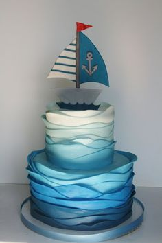 Gorgeous nautical baby shower cake with ombre blues and a sail boat topper, too adorable! Pretty Cakes, Cute Cakes, Beautiful Cakes, Amazing Cakes, Sweet Cakes, Baby Cakes, Cupcake Cakes, Pink Cakes, Food Cakes