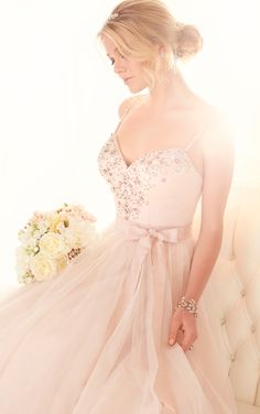 Essense of Australia's beautiful sweetheart neckline princess gowns feature beaded straps which frame the face, while the skirt shimmers under soft light.