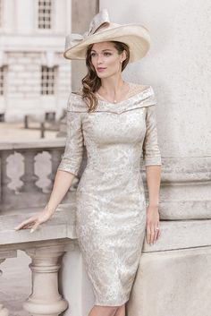 Just arrived into stock we have John Charles 26222B from their Spring Summer 2017 collection. A stylish Mother of the Bride and Mother of the Groom dress in champagne. Inspired by Old Hollywood, this stretch jacquard dress is defined by its exquisite shape which is classically feminine and fitted. The wide shoulder detail flatters elegantly, drawing the eye