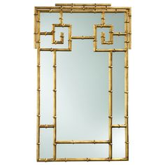 "Finished in gold, this mirror brings the classic glamour of Palm Beach style to a living room or entry way with its geometric bamboo frame. 23.5""W x 1""D x 38""H; Iron"
