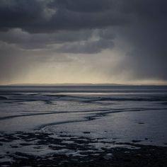 Rain above the Severn & Cardiff Flats Glamorgan. #ukcoastwalk Photo: Quintin Lake www.theperimeter.uk