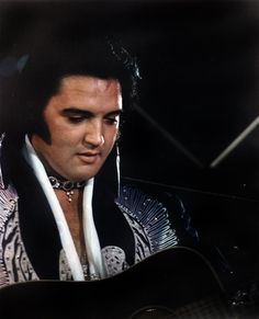 Elvis wearing the Silver Phoenix suit live onstage in June 1975 | Suit description: dark blue jumpsuit with silver bird facing left