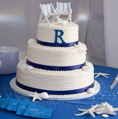 Simple white and blue beach wedding cake.  (© Long's Photography)