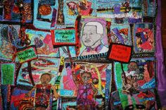 A small art quilt depicting the day Nelson Mandela became president. The quilt is all hand sewn and is 30x30