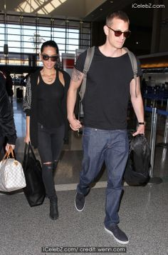 Olivia Munn and Joel Kinnaman arrive at Los Angeles International (LAX) airport http://www.icelebz.com/events/olivia_munn_and_joel_kinnaman_arrive_at_los_angeles_international_lax_airport/