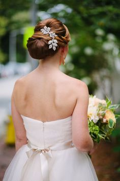 Chignon perfection with a crystal leaf hair pin: http://www.stylemepretty.com/little-black-book-blog/2014/12/04/nautical-newport-harbor-wedding/ | Photography: Lisa Rigby - http://www.lisarigbyphotography.com/