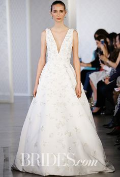 """Oscar de la Renta - Spring 2017. """"I don't like trends. Women should choose what works for them, not trends."""" So said Oscar de la Renta designer Peter Copping backstage at the brand's Spring 2017 bridal show. In keeping with that sentiment, the new Oscar de la Renta collection of wedding dresses kept things classic, and beautifully elegant, with the focus on feminine lace, embroidery, and delicate 3-D florals."""