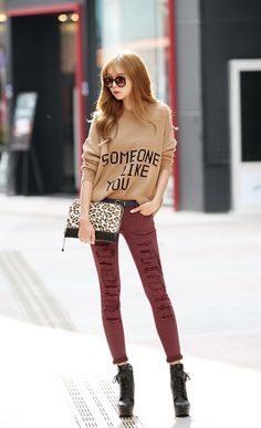 Someone like you shirt, ripped red skinny jeans, and high heeled boots