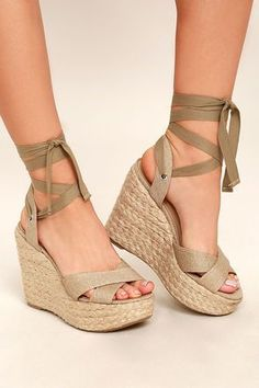13051c9a66e04 Beige canvas straps cross over a peep-toe upper