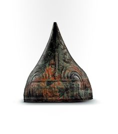 A bronze helmet with repousse decoration, Uratian  8th century B.C.