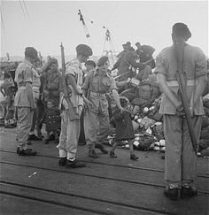 On the vessel Kadima, among her 794 ma'apilim, there were more than 100 infants and toddlers less than 3 years old. In the photo: A British soldier leading a little girl to the deportation ship in Haifa (November 1947).