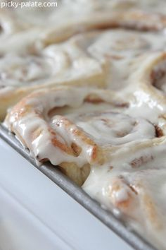 Perfect Cinnamon Rolls...sinful...must find a way to cut some of this butter