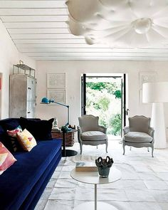 wow! super modern floor lamp, traditional chairs and sofa and the industrial dresser and then...the ceiling fixture...