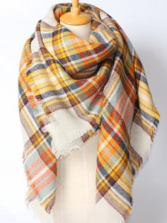 I love this scarf! The colors are perfect for fall, and a combo on a scarf that I haven't seen much of