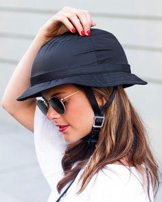 Yakkay Tokyo Black Rain Bike Helmet: A basic black hat style in a sleek, water-resistant fabrication.