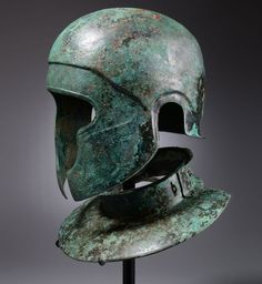 Samnite Bronze Helmet and Neckguard, C. 450 BC. This imposing helmet is a unique hybrid of the Samnite-Chalcidian type.
