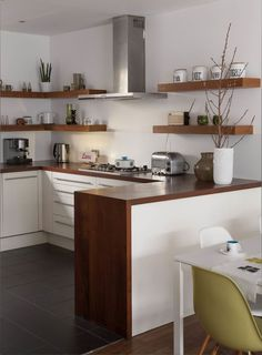 Small Space Mid-Century Kitchen Designs Bold Wooden Countertop and Creative Open Shelves. Range hood.
