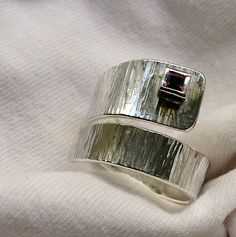 Textured silver wrap ring with 4mm sq garnet