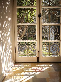In the breakfast nook, French encaustic tile and wrought iron details are original to the house.