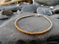 Hey, I found this really awesome Etsy listing at https://www.etsy.com/uk/listing/397931265/silver-and-gold-seed-bead-bracelet