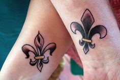 fleur de lis tattoo's, i like the one on the left! Maybe behind the ear?