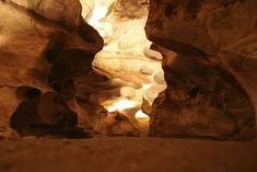 Explore the eerily beautiful natural wonder of Longhorn Caverns.