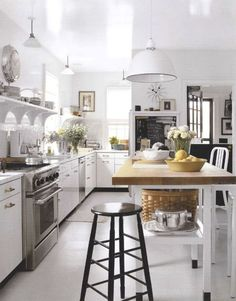 I could never keep a white kitchen, but I sure like to look at them.