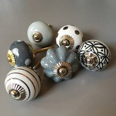 A gorgeous set of drawer knobs in greys and silvers.We've hand picked this beautiful set of drawer knobs which compliment each other perfectly. Perfect for perking up an old chest of drawers, dresser or cabinet. The knobs are very easy to fit and can really transform the look of an old piece of furniture. These drawer knobs in greys and silvers would look super chic in any room! Choose from a set of 6, 9 or 12 from the drop down menu. Codes 123, 140, 177, 179, 188, 213Ceramic and…