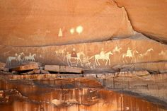 """On the Dirt Road"" with Ernie and Nancy ""Narbona Expedition""  Canyon de Chelly, AZ. This photo was taken about 100 yards away. The horses and riders stand about 3 feet tall. This is the most striking pictograph site we have ever seen."