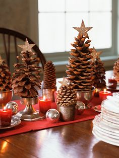 Christmas Tablescape. A great idea for decorating with pinecones. Notice the different sizes and shapes used to make varying heights.