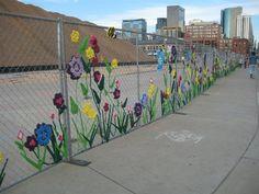Guerilla crochet artists beautified this Denver construction site.