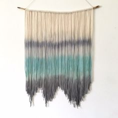 Beautiful dip dyed tapestry. This boho wall hanging was hand dyed shades of teal and gray. It was made with love by hanging hundreds of light-weight cotton-blen