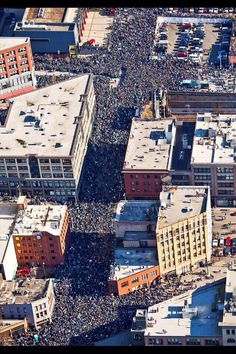 Now this is just beyond... A view of the Seahawks victory parade from above. 700,000+ people. Go Hawks! Go 12's!
