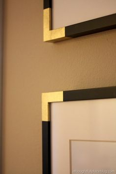 DIY gold frame corners for picture wall...kind of mimics old photo albums.