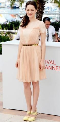 Look of the Day › May 17, 2012 WHAT SHE WORE Cotillard arrived for a Cannes Film Festival Rust & Bone press event in a belted Christian Dior cocktail dress and pastel pumps.