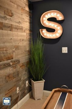 "Stikwood"" peel &stick wood on this basement wall"