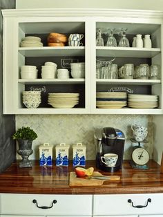 See how doorless cabinets and butcher block countertops bring this cottage kitchen to life on HGTV.com.