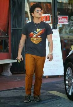 Bruno Mars in his cute little mustard yellow pants. His casual style is tooo cute