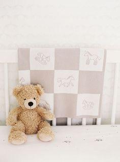 neutral crib + teddy bear