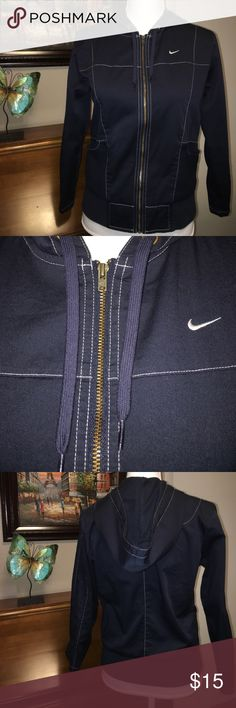 Nike jacket Armpit to armpit is 18 1/2 inches. Length from shoulder is 22 inches. Very nice lightweight jacket. Navy color. Nike Jackets & Coats