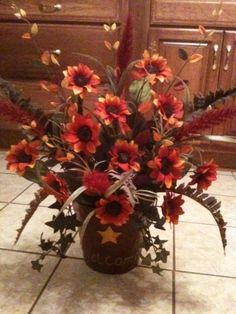 Hanging wall flower arrangement for a primitive/country setting or can be used on a door or covered porch.