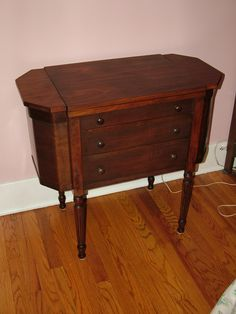 Martha Washington sewing cabinet, had a White sewing machine in it originally.  Rescued it, refinished it with refinisher.