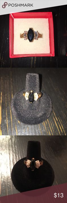 Black and Gold Ring Black stone with diamond like baguettes in a gold metal! Jewelry Rings
